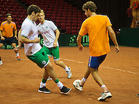 11-sept.-2013,Netherlands, Groningen,  Martini Plaza, Tennis, DavisCup Netherlands-Austria, Practice, Footbal Club FC Groningen is visiting the Dutch Daviscup team and playing a football match on the clay court, The tennis players won 2-1<br /> Photo: Henk Koster