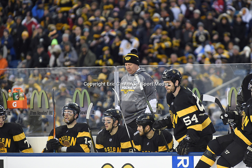 Friday January 1, 2016: Boston Bruins head coach Claude Julien stands on the bench during the National Hockey League Bridgestone Winter Classic game between the Montreal Canadiens and the Boston Bruins, held at Gillette Stadium in Foxborough, Massachusetts. Montreal defeats Boston 5-1 in regulation time. Eric Canha/CSM