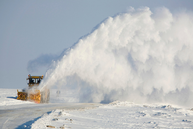 A snow blower clearing a winter road near the Yurharovo gas field north of Noviy Urengoi. Yamal, Western Siberia, Russia