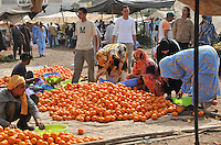 People buying oranges on the market