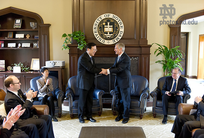 Apr. 9, 2013; The Honorable Hao Ping, Vice Minister for Education, People's Republic of China, and University of Notre Dame Provost Thomas Burish sign an agreement between Notre Dame and the Ministry of Education's China Scholarship Council to support numerous graduate students from China pursuing doctoral degrees at Notre Dame.  Notre Dame is one of four universities in the United States to have such an agreement...Photo by Matt Cashore/University of Notre Dame