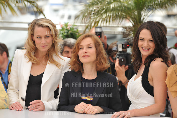 Robin Wright Penn (left), Isabelle Huppert & Asia Argento at the Jury photocall at the 62nd Festival de Cannes..May 13, 2009  Cannes, France.Picture: Paul Smith / Featureflash