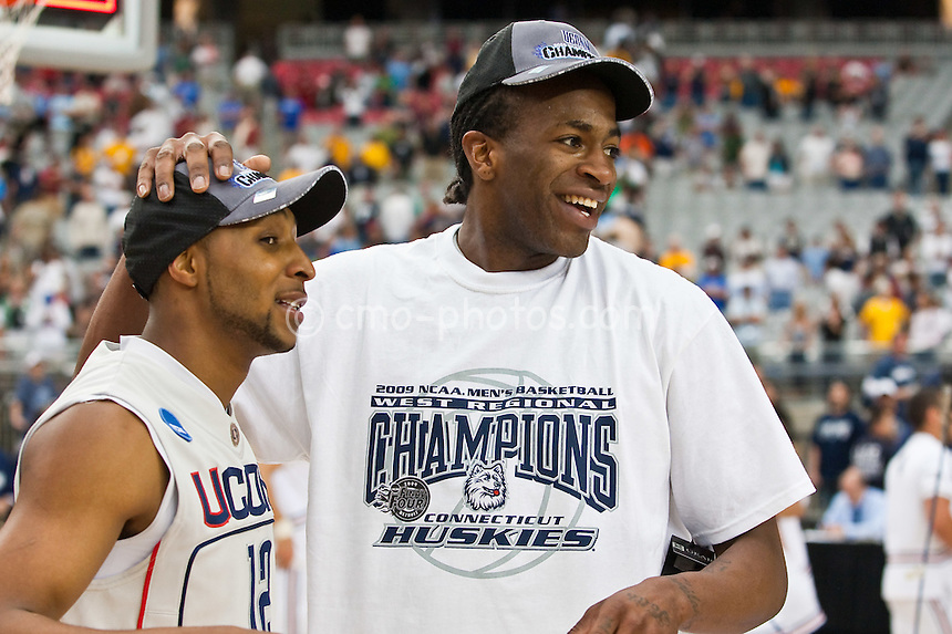 Mar 28, 2009; Glendale, AZ, USA; Connecticut Huskies guard A.J. Price (12) and forward Stanley Robinson (right) celebrate following the Huskies' 82-75 victory over the Missouri Tigers in the finals of the west region of the 2009 NCAA basketball tournament at University of Phoenix Stadium.  With the win, the Huskies advance to the Final Four.