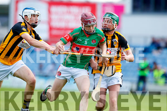 Donal Hunt Crotta O'Neills in action against Abbeydorney/Tralee Parnells Tadhg Brick and Cillian Spillane in the Minor Hurling County Final   at Austin Stack Park on Sunday.
