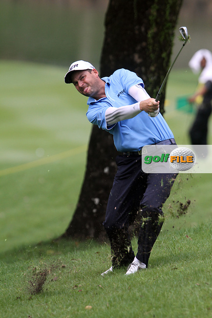 David Howell (ENG) hits his second shot out of the trees on the 1st during Round 3 of the 2013 Maybank Malaysian Open, Kuala Lumpur Golf and Country Club, Kuala Lumpur, Malaysia 23/3/13...(Photo Jenny Matthews/www.golffile.ie)