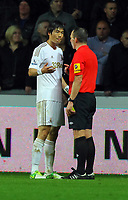 Saturday, 03 November 2012<br /> Pictured: Ki Sung Yueng of Swansea (L) speaks to match referee K Friend (R) after he was shown a yellow card<br /> Re: Barclays Premier League, Swansea City FC v Chelsea at the Liberty Stadium, south Wales.