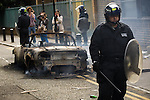 © Joel Goodman - 07973 332324 . 08/08/2011 . London , UK . Police in Hackney guarding a burned out car on a 3rd night of rioting and looting in London , which followed a protest against the police shooting of Mark Duggan in Tottenham . Photo credit : Joel Goodman