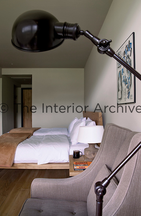 A simple contemporary wooden bed furnishes another of the hotel's bedrooms