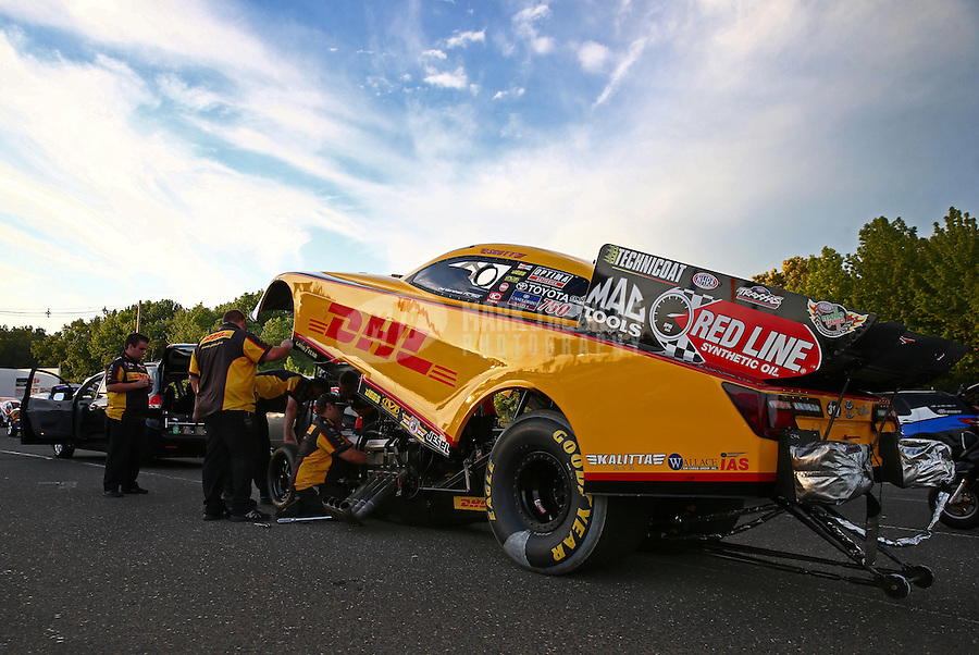 May 31, 2013; Englishtown, NJ, USA: NHRA crew members for funny car driver Del Worsham during qualifying for the Summer Nationals at Raceway Park. Mandatory Credit: Mark J. Rebilas-