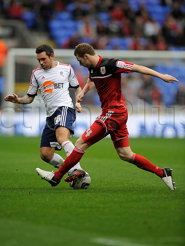 20.10.2012 Bolton, England.Mark Davies of Bolton  and Liam Fontaine of Bristol City  in action during the Championship game between Bolton Wanderers and Bristol City from the Reebok Stadium.