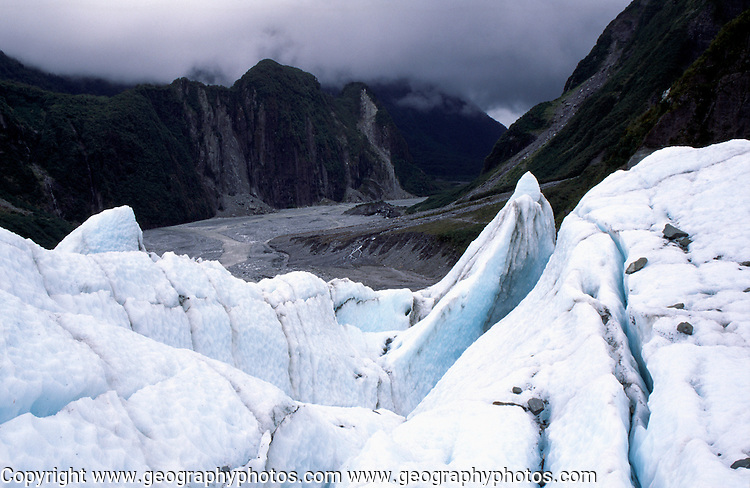 View down the U shaped glacial trough from near the front of the Fox glacier, New Zealand