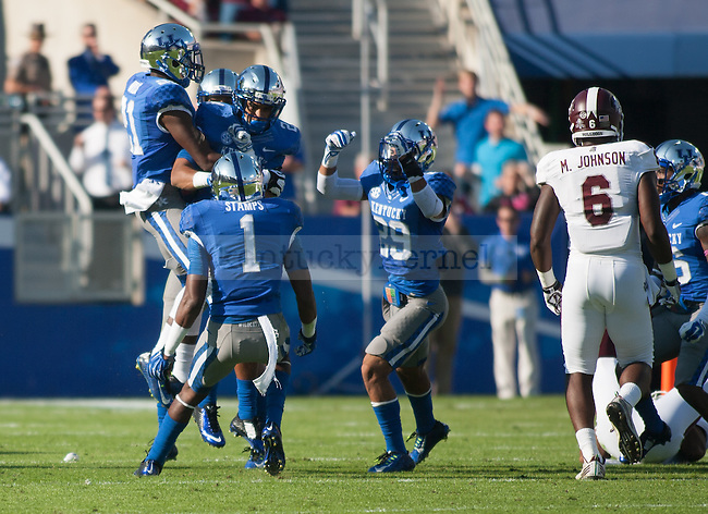 The UK football team celebrates during the first half of the Kentucky Wildcats game against the Mississippi State Bulldogs at Commonwealth Stadium on Saturday, October 25, 2014 in Lexington, Ky. Mississippi leads Kentucky 17-10. Photo by Adam Pennavaria | Staff