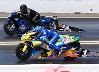 May 31, 2014; Englishtown, NJ, USA; NHRA pro stock motorcycle rider Matt Smith (near lane) races alongside Joe DeSantis during qualifying for the Summernationals at Raceway Park. Mandatory Credit: Mark J. Rebilas-