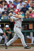 Arkansas Razorbacks outfielder Andrew Benintendi (16) follows through on his swing during the NCAA College baseball World Series against the Miami Hurricanes on June 15, 2015 at TD Ameritrade Park in Omaha, Nebraska. Miami beat Arkansas 4-3. (Andrew Woolley/Four Seam Images)