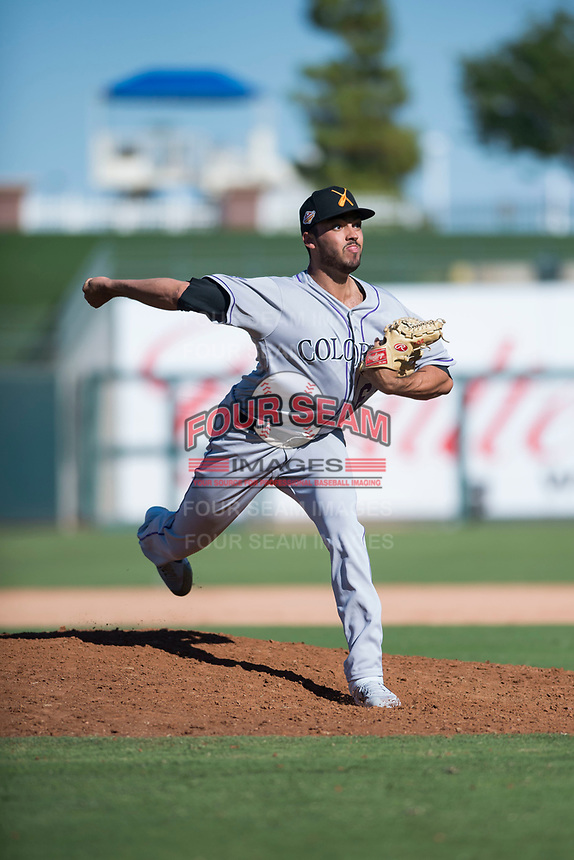 Salt River Rafters relief pitcher Justin Lawrence (61), of the Colorado Rockies organization, delivers a pitch during an Arizona Fall League game against the Surprise Saguaros on October 9, 2018 at Surprise Stadium in Surprise, Arizona. The Rafters defeated the Saguaros 10-8. (Zachary Lucy/Four Seam Images)