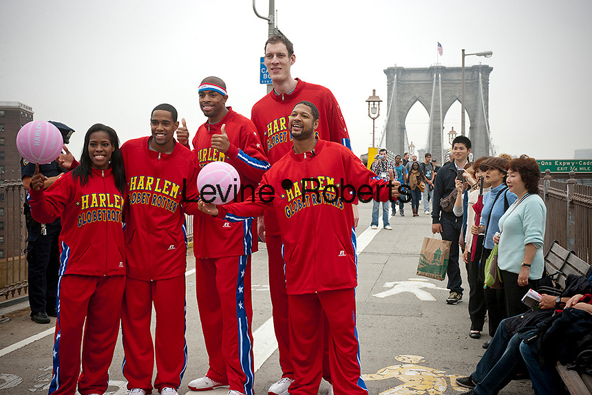 (L-R) TNT Maddox, Cheese Chisholm, Hammer Harrison, Tiny Sturgess and Handles Franklin of the Harlem Globetrotters basketball team dribble and perform across the Brooklyn Bridge in New York on Wednesday, October 3, 2012 during a promotional event. The iconic team will play their first-ever game in Brooklyn at the spanking brand new Barclays Center on Sunday, October 7.(© Richard B. Levine)