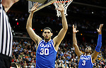 Eloy Vargas and Terrence Jones throw their hands up at the referee in the second half of UK's Sweet 16 NCAA tournament game against Ohio State at the Prudential Center in Newark, New Jersey on Friday, March 25, 2011.  Photo by Britney McIntosh | Staff