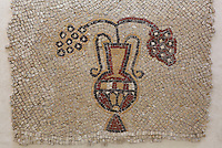 Mosaic depicting a vase with bunches of grapes from the Al-Mukhayyat monastery, Khirbat al-Mukhayyat (Nebo), Mount Nebo, Jordan, now in the Mount Nebo Museum. In the 5th and 6th centuries, three Byzantine churches and a monastery paved with mosaics were built in the village of Nebo. Picture by Manuel Cohen