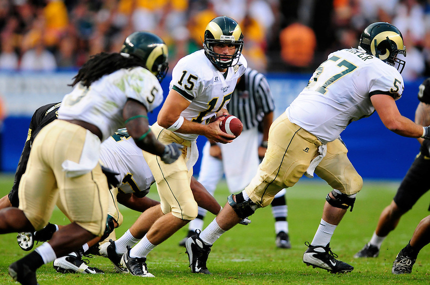 31 Aug 2008: Colorado State quarterback Billy Farris looks to hand off to running back Gartrell Johnson.  The Colorado Buffaloes defeated the Colorado State Rams 38-17 at Invesco Field at Mile High in Denver, Colorado. FOR EDITORIAL USE ONLY