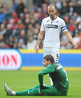Swansea City's Mike van der Hoorn checks on injured goalkeeper Kristoffer Nordfeldt<br /> <br /> Photographer Kevin Barnes/CameraSport<br /> <br /> The EFL Sky Bet Championship - Swansea City v Preston North End - Saturday August 11th 2018 - Liberty Stadium - Swansea<br /> <br /> World Copyright &copy; 2018 CameraSport. All rights reserved. 43 Linden Ave. Countesthorpe. Leicester. England. LE8 5PG - Tel: +44 (0) 116 277 4147 - admin@camerasport.com - www.camerasport.com