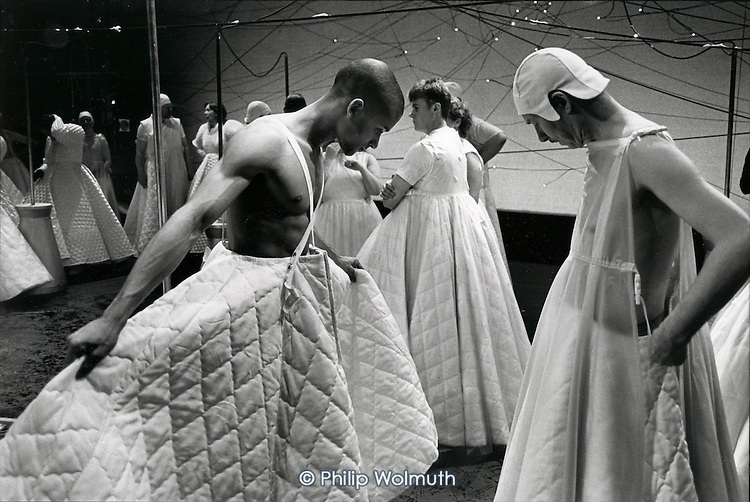 A dancer and a member of the chorus compare skirts during a costume rehearsal for the world premiere of Gavin Bryar's opera Doctor Ox's Experiment., with the English National Opera directed by Atom Egoyan at the Coliseum, London.