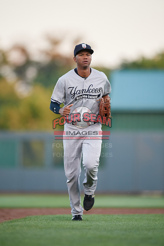 Staten Island Yankees right fielder Junior Soto (48) jogs back to the dugout during a game against the Aberdeen IronBirds on August 23, 2018 at Leidos Field at Ripken Stadium in Aberdeen, Maryland.  Aberdeen defeated Staten Island 6-2.  (Mike Janes/Four Seam Images)