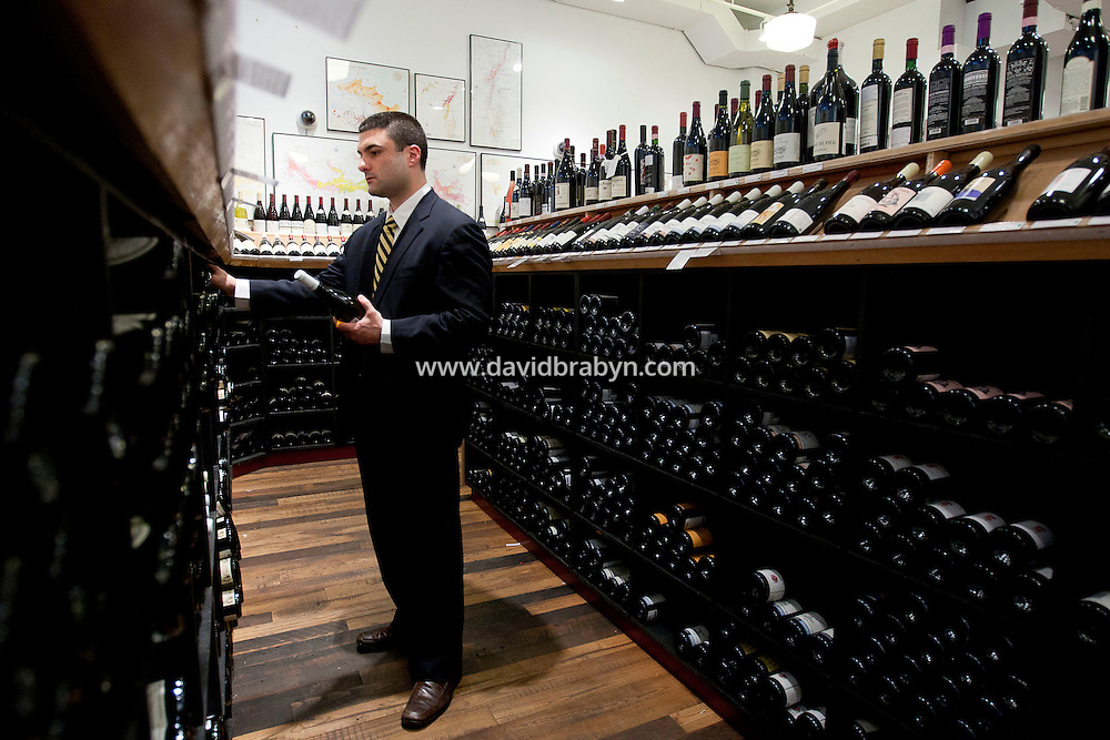 A man in a suit shops at Chambers Street Wines in New York, NY, USA, 22 May 2009. The store specializes in naturally made wines from artisanal small producers and has received a Slow Food NYC Snail of Approval.