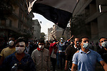 Demonstrators walk down Mohamed Mahmoud Street toward police protecting the Ministry of the Interior near Tahrir Square in Cairo, Egypt, Tuesday, November 22, 2011. Clashes between Central Security Forces and demonstrators demanding an end to military rule continued into a fourth day.