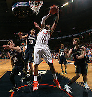 Virginia forward Akil Mitchell (25) shoots next to Notre Dame defenders during the game Saturday, February 22, 2014,  in Charlottesville, VA. Virginia won 70-49.