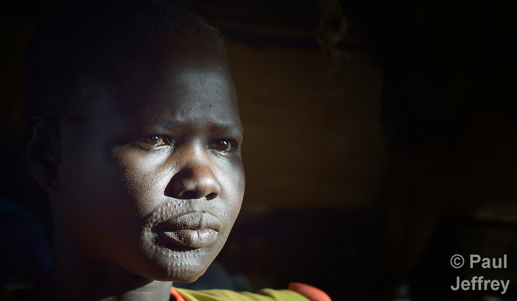 Bewen Yuot, a Dinka woman who was displaced by fighting near her home in Bentieu, South Sudan, today lives with relatives in Ajuong Thok, on the edge of a camp filled with thousands of refugees from Sudan's Nuba Mountains.
