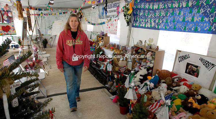 NEWTOWN, CT. 06 February 2013-020613SV01-Chaplain Renee Gilbert is on hand to greet guests at gathering place just off I84 at exit 10 in Newtown Wednesday. The tent that sprang up just after the Sandy Hook Elementary School shooting has become a place for people to mourn the victims..Steven Valenti Republican-American