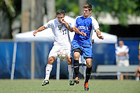 2 October 2011:  Kentucky defender Brad Walker (5) punches FIU midfielder/forward Mario Uribe (17) while battling for the ball in the second half as the FIU Golden Panthers defeated the University of Kentucky Wildcats, 1-0 in overtime, at University Park Stadium in Miami, Florida.