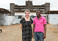 Soka J. Moses, MD stands with Occidental College professor Mary Beth Heffernan at the Ministry of Defense Ebola Treatment Center in Monrovia, Liberia, Feb. 28, 2015.<br /> (Photo by Marc Campos, Occidental College Photographer) Mary Beth Heffernan, professor of art and art history at Occidental College, works in Monrovia the capital of Liberia, Africa in 2015. Professor Heffernan was there to work on her PPE (personal protective equipment) Portrait Project, which helps health care workers and patients fighting the Ebola virus disease in West Africa.<br />