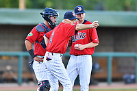 Elizabethton Twins catcher Rainis Silva (6), manager Ray Smith (2) and starting pitcher Charlie Barnes (21) on the mound as Smith calls for a relief pitcher during a game against the Pulaski Yankees at Joe O'Brien Field on June 27, 2016 in Elizabethton, Tennessee. The Yankees defeated the Twins 6-4. (Tony Farlow/Four Seam Images)