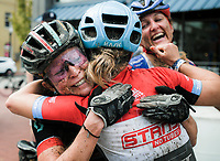 NWA Democrat-Gazette/CHARLIE KAIJO Erin Huck of Boulder, Colo. (left) hugs Chloe Woodruff of Prescott Ariz. after placing first in the women's race of the Epic Rides Oz Trails championship mountain bike race, Sunday, October 7, 2018 at the downtown square in Bentonville. Woodruff forfeited her chance to win by giving Huck one of her wheels so she could finish the race.<br />