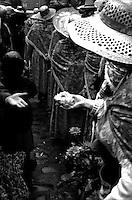 Women offering flower during a festival in Montmartre.<br /> <br /> Femme offrant une fleur pendant la f&ecirc;te des vendanges de Montmartre.