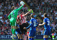 Tranmere Rovers' Scott Davies gets above Lincoln City's Matt Rhead to punch clear<br /> <br /> Photographer Andrew Vaughan/CameraSport<br /> <br /> The EFL Sky Bet League Two - Lincoln City v Tranmere Rovers - Monday 22nd April 2019 - Sincil Bank - Lincoln<br /> <br /> World Copyright © 2019 CameraSport. All rights reserved. 43 Linden Ave. Countesthorpe. Leicester. England. LE8 5PG - Tel: +44 (0) 116 277 4147 - admin@camerasport.com - www.camerasport.com