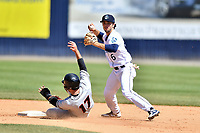 Asheville Tourists shortstop Terrin Vavra (6) fields the throw and makes the turn on a double play over a hard sliding Robbie Thorburn (17) during a game against the Delmarva Shorebirds at McCormick Field on May 5, 2019 in Asheville, North Carolina. The Shorebirds defeated the Tourists 10-9. (Tony Farlow/Four Seam Images)