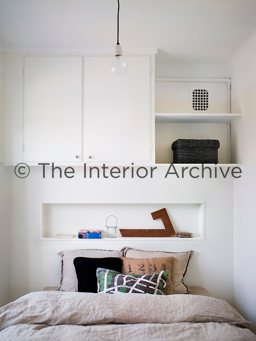 Every inch of the apartment has been used for storage, including the walls above the bed