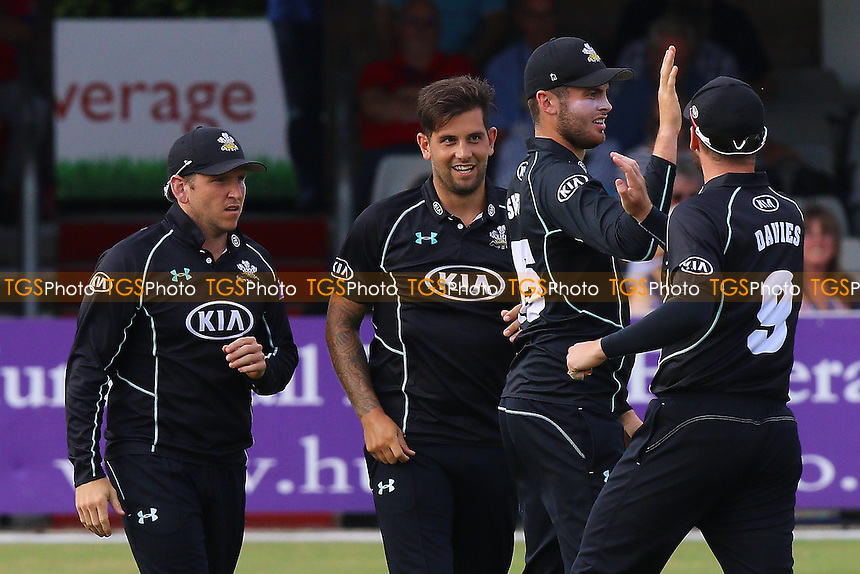 Jade Dernbach (C) of Surrey is congratulated by his team mates after taking the wicket of Graham Napier during Essex Eagles vs Surrey, Royal London One-Day Cup Cricket at the Essex County Ground on 24th July 2016