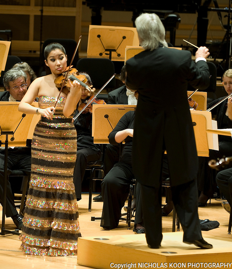 Violinist Sarah Chang performs Felix Mendelssohn's Concerto in E Minor for Violin and Orchestra (Op. 64) with the Pacific Symphony conducted by Carl .St. Clair on Thursday at the Rene and Henry Segerstrom Concert Hall. It was the season opener concert for the Pacific Symphony.