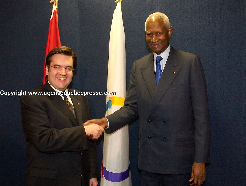 March 18, Montreal, Quebec, Canada<br /> <br /> Denis Coderre, Minister in charge of Francophonie (L) and Abou Diouf, General Secretary, Francophonie International Organisation (O.I.F.) (R) adress the medias<br /> March 18 2004 in Montreal, Canada.<br /> <br /> Abou Diaf was attending the signature of a partnership between that Francophonie Universities Agency (AUF) and the African Virtual University (UVA).<br /> <br /> <br /> Mandatory Credit: Photo by Sevyl- Images Distribution. (&copy;) Copyright 2004 by Pierre Roussel
