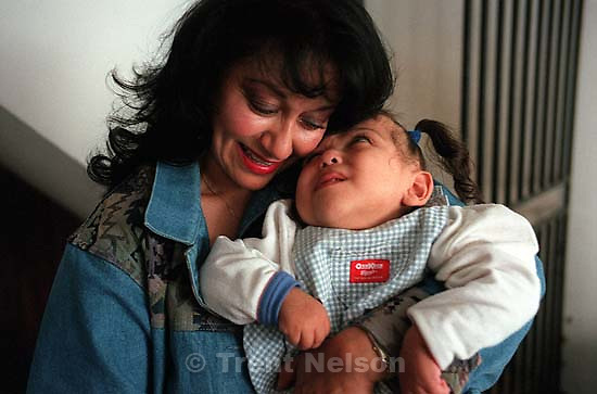 Lilia de Larios holds Bessy Formerly conjoined twins, Bessy and Doris Gonzales.<br />