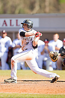 Danny Weiss #8 of the Davidson Wildcats follows through on his swing against the College of Charleston Cougars at Wilson Field on March 12, 2011 in Davidson, North Carolina.  The Wildcats defeated the Cougars 8-3.  Photo by Brian Westerholt / Four Seam Images