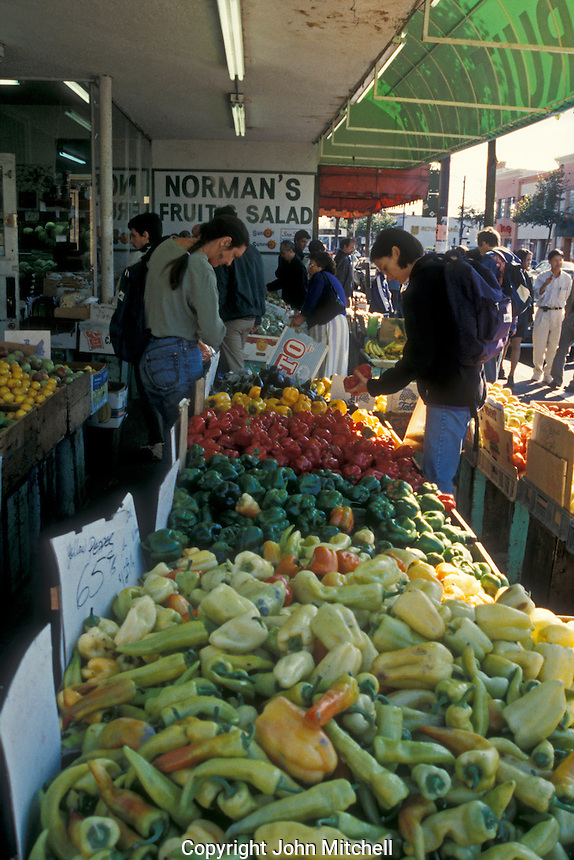 People shopping for vegetables and fruit on Commercial Drive in Vancouver, British Columbia, Canada