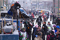 March 3, 2012 DeeDee Jonrowe's handlers lower her dog sleds to Mike Jonrowe at the Ceremonial Start of Iditarod 2012 in downtown Anchorage, Alaska.