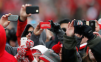 Fans take photos with their phones during the Ohio State football National Championship celebration at Ohio Stadium on Saturday, January 24, 2015. (Columbus Dispatch photo by Jonathan Quilter)