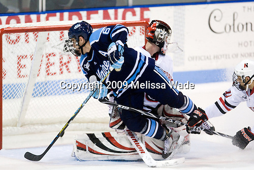 Chris Wideman (Miami - 6), Chris Rawlings (NU - 37), Justin Daniels (NU - 11) - The University of Maine Black Bears defeated the Northeastern University Huskies 6-2 on Friday, November 13, 2009, at Matthews Arena in Boston, Massachusetts.
