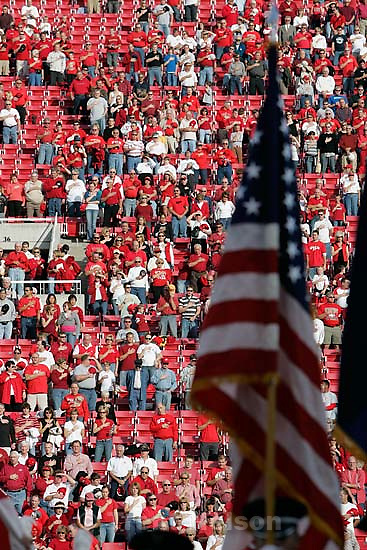 fans with flag at national anthem. Utah vs. San Diego State University college football.<br />