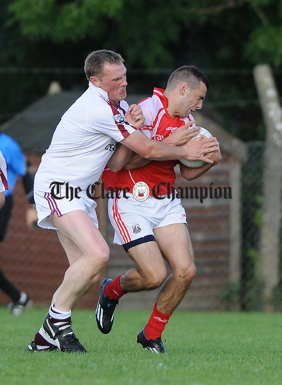 Dean Ryan of Eire Og in action against Joe Considine of Liscannor during their senior championship game in Corofin. Photograph by John Kelly.